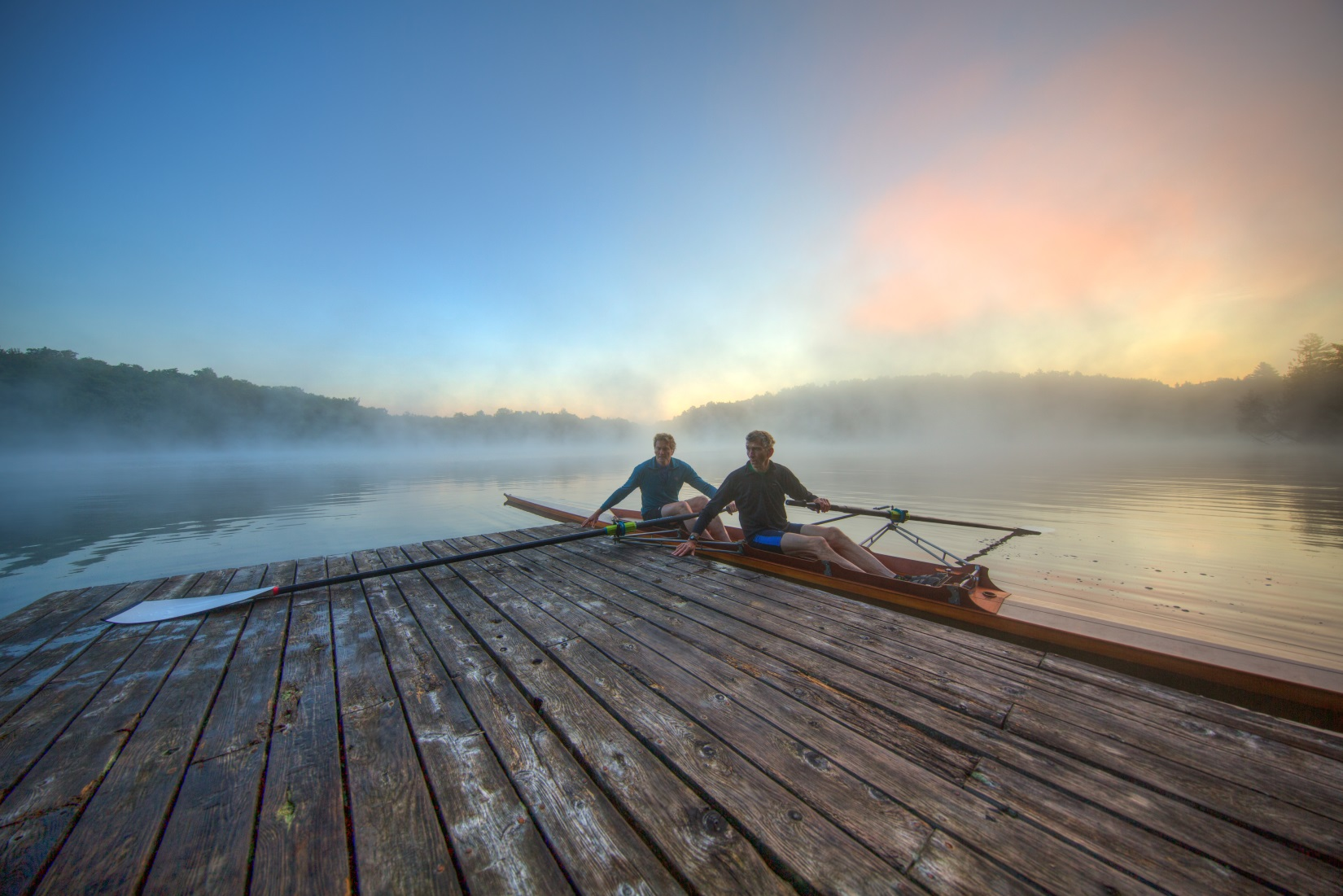 Founders Dick and Peter continue to innovate and personally test each product. Here they are heading out for an early morning oar-testing session in their 1984 wooden Stämpfli pair on Big Hosmer Pond, Craftsbury, Vermont.