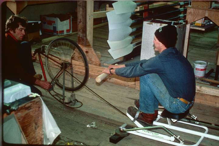 Peter and Dick decide to create a winter training device for rowers. They nail an old bicycle to the floor of the barn and pull on the free end of the chain—the Model A Indoor Rower is born.<br><br><i>Dick Dreissigacker (l.) and Jon Williams (r.). Jon is still at Concept2!</i>